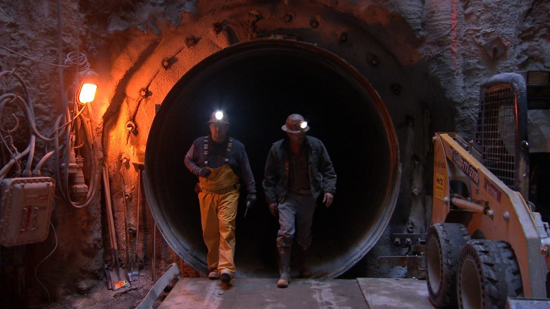 Workers with the San Francisco Public Utilities Commission inspect the New Irvington Tunnel, which opened in March 2015. Image by Owen Bissell for KQED Science