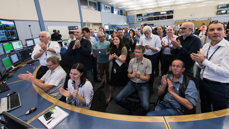 Researchers at the Large Hadron Collider in Switzerland celebrate in June after the powerful atom smasher started a series of experiments in which particles collided at double the energy level ever recorded.