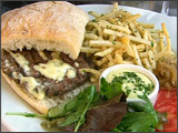 Hamburger on a French Roll with Aïoli and French Fries