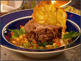 Confit Lamb Shoulder with Flageolets and Crisp Red Onions