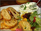 Warm Goat Cheese and Crostini with Pickled Beets and Frisee