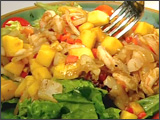 Mango Salad with Bell Peppers, Seared Scallops, and Shrimp over Greens with Raspberry Vinaigrette