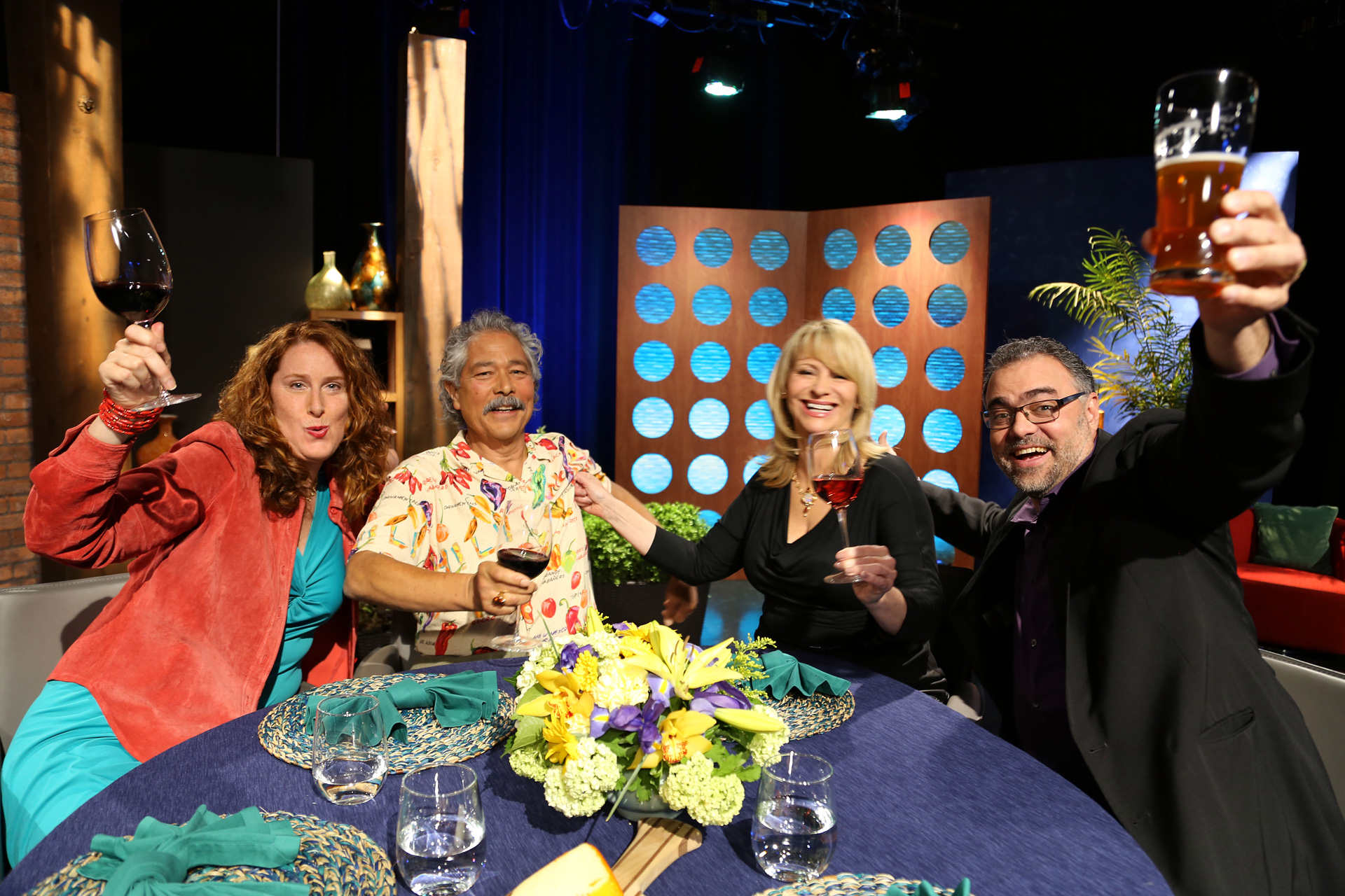 Host Leslie Sbrocco and guests having fun on the set of the episode 13 of season 11.