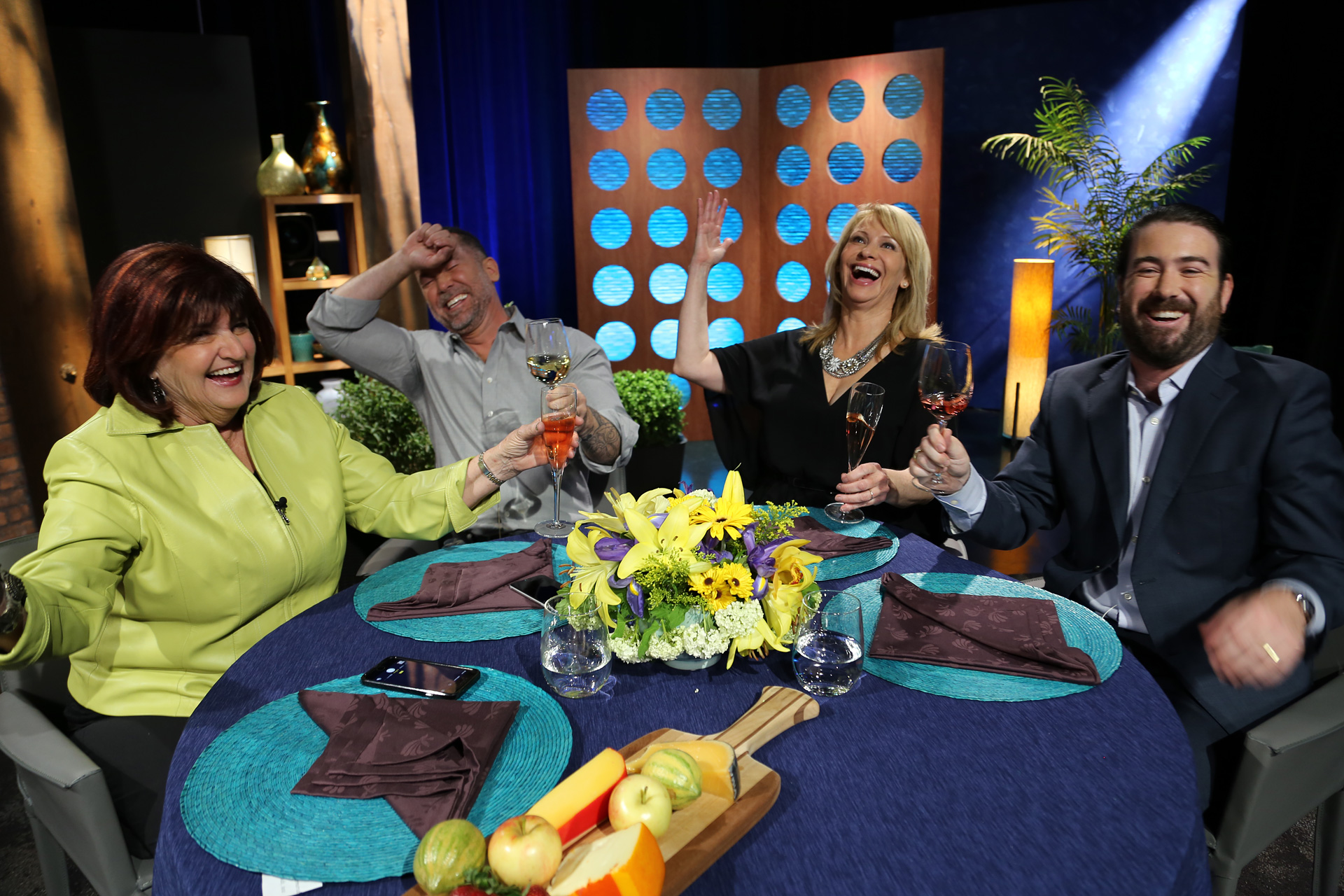 Host Leslie Sbrocco and guests having fun on the set of the episode 16 of season 11.