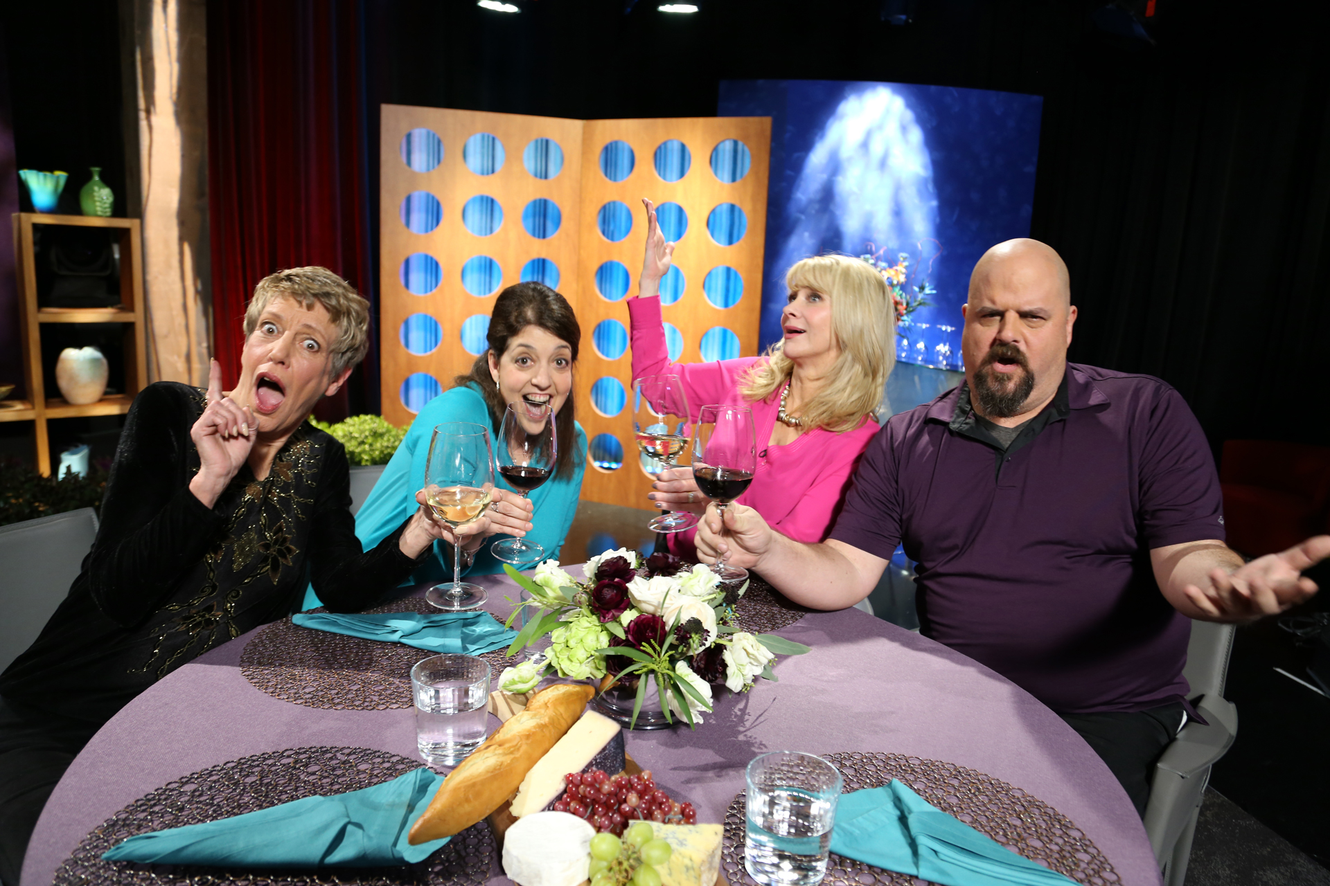 Host Leslie Sbrocco and guests having fun on the set of the premiere episode of season 12.
