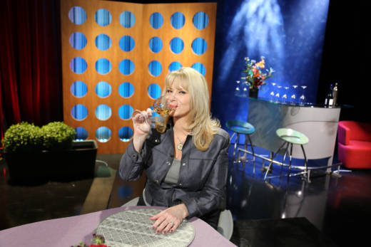Host Leslie Sbrocco drinking wine on the set of Check, Please! Bay Area