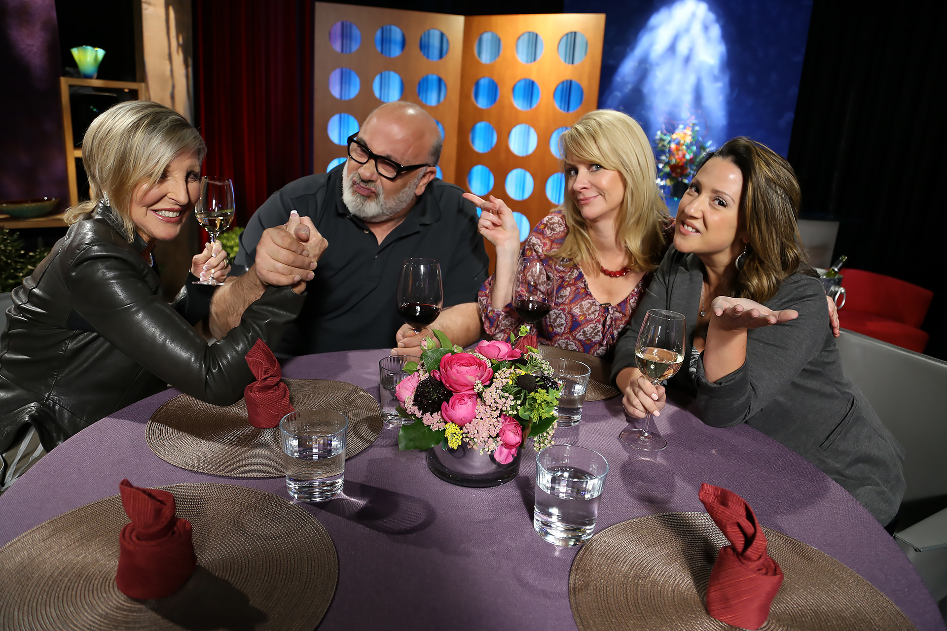 Host Leslie Sbrocco and guests having fun on the set of season 12 episode 18.