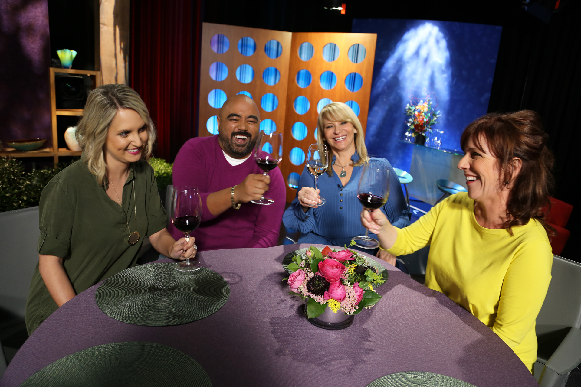 Host Leslie Sbrocco and guests having fun on the set of season 12 episode 19.
