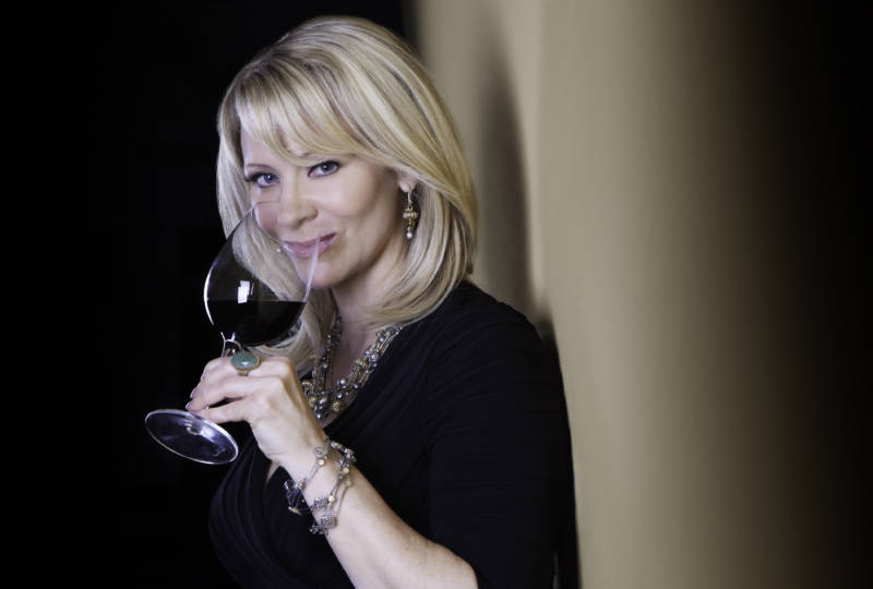 Host Leslie Sbrocco sipping wine