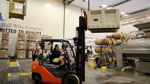 Winemaker Shauna Rosenblum crushes grapes at Rock Wall Wine Company