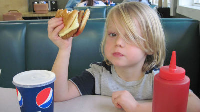 A child holding a veggie burger