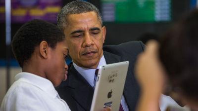 President Barack Obama tours a seventh grade classroom.
