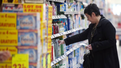 A woman shops in the detergent section