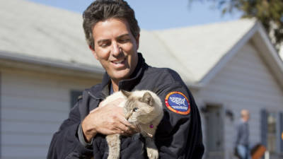 The HSUS President and CEO Wayne Pacelle is seen here with a rescued cat.