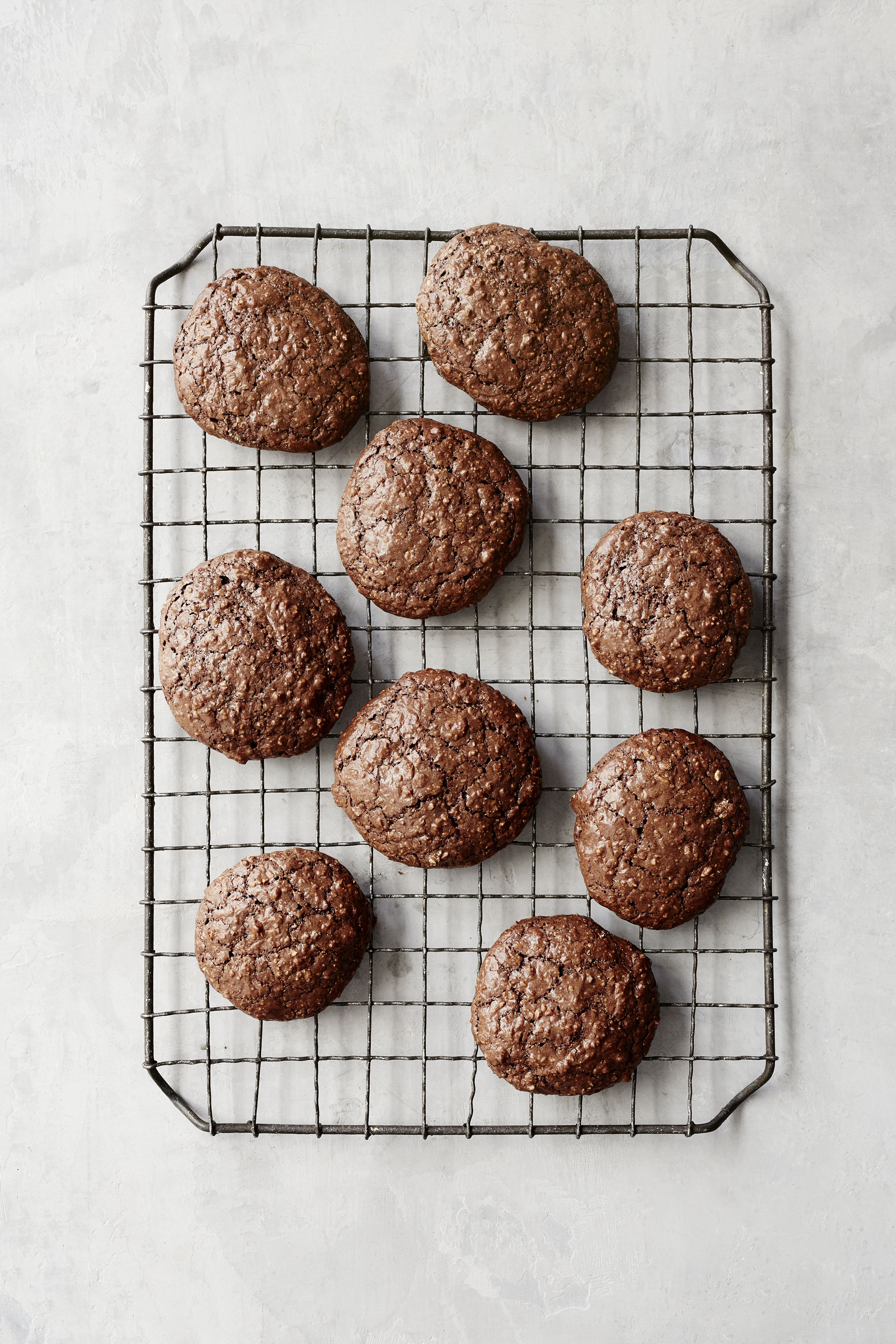 chocolate flourless cookies on a cooling rack