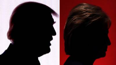 silhouettes of Donald Trump and Hillary Clinton