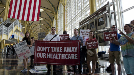 Protesters greet senators leaving Ronald Regan Washington National Airport in Terminal B on June 22, 2017 in Washington, DC