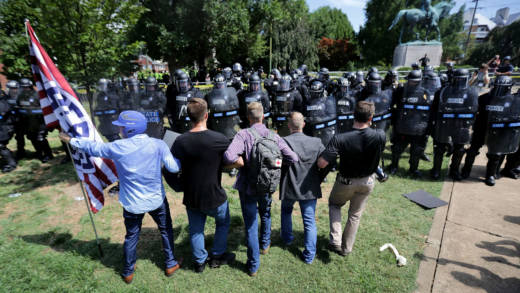 A small group of white nationalists, neo-Nazis and members of the 'alt-right' face off with Virginia State Police in front of the statue of General Robert E. Lee after the 'Unite the Right' rally was declared an unlawful gathering August 12, 2017 in Charlottesville, Virginia. After clashes with anti-fascist protesters and police the rally was declared an unlawful gathering and people were forced out of Emancipation Park, where a statue of Confederate General Robert E. Lee is slated to be removed