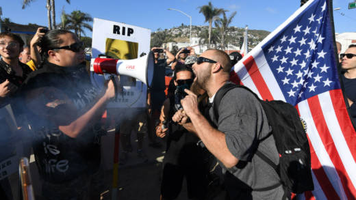 Counter protesters (L) argue with supporters of US President Donald Trump during dual rallies with the 'America First' group in Laguna Beach, California, on August 20, 2017.