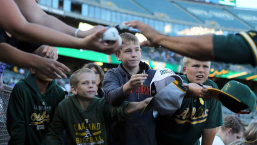 Young fans wait for autographs from Coco Crisp #4 of the Oakland Athletics before the game against the Tampa Bay Rays at the Oakland-Alameda Coliseum on July 22, 2016 in Oakland, California.