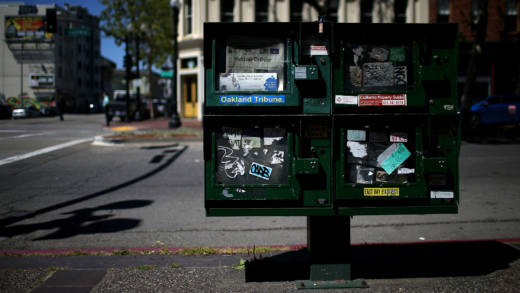 The final edition of the Oakland Tribune is displayed in a newspaper rack on April 4, 2016 in Oakland, California. After a 142 years, the final edition of of the Oakland Tribune was printed today. The Bay Area News Group's flagship daily will be replaced with the East Bay Times, a consolidation of other Bay Area News Group papers. (Photo by Justin Sullivan/Getty Images)