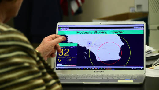 Margaret Vinci, manager of the Seismological Laboratory at California Institute of Technology (Caltech) points to a shake alert user display on a laptop screen, set for a limited release on June 1, 2017 at the Caltech Seismological Laboratory in Pasadena, California, where they addressed the elimination of federal funding for the West Coast Earthquake early Warning system, also known as ShakeAlert, in President Trump's FY2018 budget.