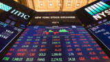 A video board displays the closing numbers after the closing bell of the Dow Industrial Average at the New York Stock Exchange on December 6, 2017 in New York.