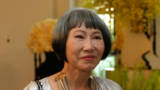 Author Amy Tan arrives at a State Dinner in honor of Prime Minister Lee Hsien Loong of Singapore at the White House in Washington on August 2, 2016.
