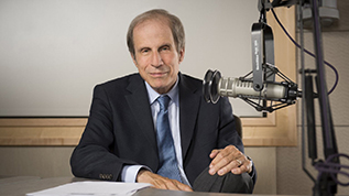 Michael Krasny at a microphone