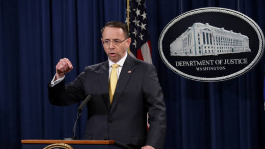 Rod Rosenstein at a podium.