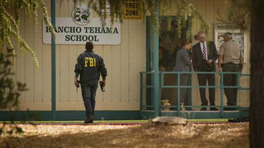 FBI agents are seen behind yellow crime scene tape outside Rancho Tehama Elementary School after a shooting in the morning on November 14, 2017, in Rancho Tehama, California.