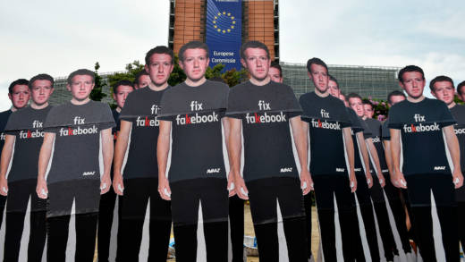 Global activists of Avaaz, set up cardboard cutouts of Facebook chief Mark Zuckerberg, on which is written 'Fix Fakebook', in front of the European Union headquarters in Brussels, on May 22, 2018, as they call attention to what the groups says are hundreds of millions of fake accounts still spreading disinformation on Facebook.