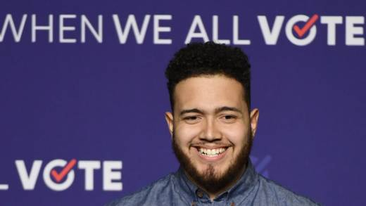 Youth organizer Aaron Ibarra speaks before introducing former first lady Michelle Obama at a rally for When We All Vote's National Week of Action at Chaparral High School on September 23, 2018 in Las Vegas, Nevada.