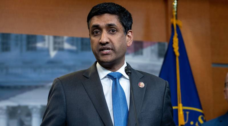 Ro Khanna stands behind podium addressing the press