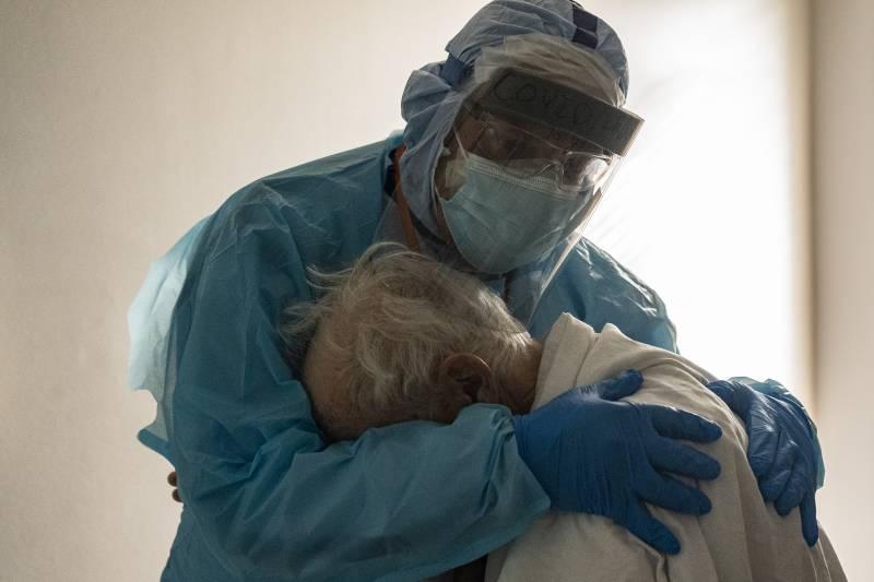 doctor hugs patient