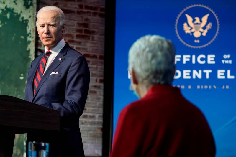 Joe Biden looks towards appointee for National Climate Advisor, Gina McCarthy, as he announces his climate and energy team will advance an ambitious agenda to address issues of climate change
