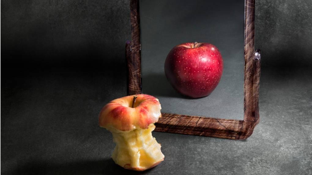 chewed apple sees self as full in mirror