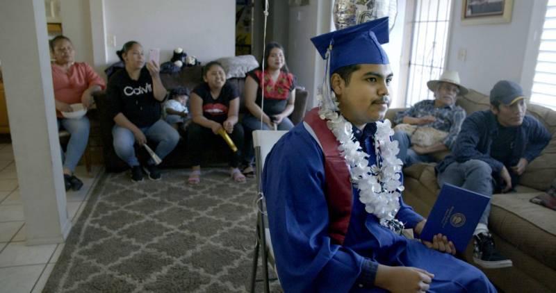 Denilson Garibo graduates over Zoom in the documentary 'Homeroom.'