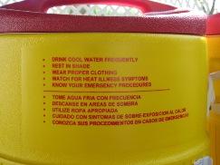 Water cooler imprinted with heat safety tips. Photo: Sasha Khokha