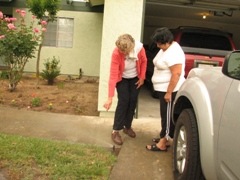 City water conservation specialist Marilyn Creel shows Fresno resident Mary Ann Evans how to adjust her sprinklers to point them away from the sidewalk.