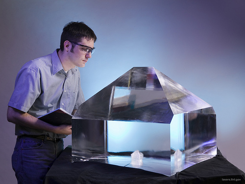 """A NIF technician appears to be gazing into a """"crystal ball,"""" which is actually used to amplify laser beams--but not much good for predicting the future. Photo: Lawrence Livermore National Lab"""
