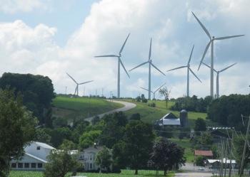 Giant wind turbines dwarf dairy farms in northern New York. Photo: Craig Miller