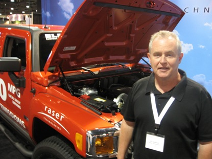 Jim Spellman of Raser Technologies, standing in front of the 100-mpg Electric Hummer. Photo: Rob Schmitz
