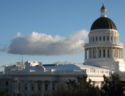 A cloud settles over the state capitol. Photo: Craig Miller