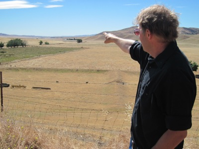 Standing at the valley's north end, BLM ecologist Mike Westphal points to where 2,000 acres might be covered in PV solar panels. (Photo: Craig Miller)