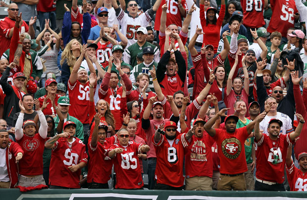 San Francisco 49ers fans celebrate a touchdown in September in New York. (Elsa/Getty Images)