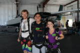 Roadtrippers Zachariah, Jackie, and Megan prepare to skydive!