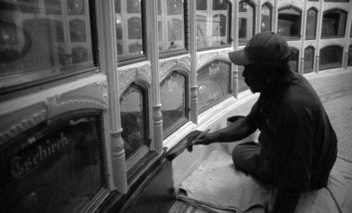 Emmitt Watson touching up paint in the Columbarium.
