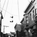 Shoes hang from wires in the Mission.
