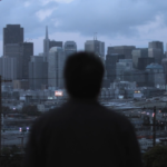 Gil looking out at the San Francisco skyline